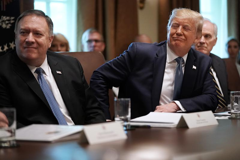 WASHINGTON, DC - JULY 16: U.S. President Donald Trump listens to a presentation about prescription drugs during a cabinet meeting with Secretary of State Mike Pompeo (L), acting Defense Secretary Richard Spencer and others at the White House July 16, 2019 in Washington, DC. Trump and members of his administration addressed a wide variety of subjects, including Iran, opportunity zones, drug prices, HIV/AIDS, immigration and other subjects for more than an hour. (Photo by Chip Somodevilla/Getty Images) ORG XMIT: 775374453 ORIG FILE ID: 1162404480