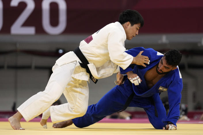 An Changrim of South Korea, left, and Tohar Butbul of Israel compete during their men's -73kg quarterfinal judo match at the 2020 Summer Olympics in Tokyo, Japan, Monday, July 26, 2021. (AP Photo/Vincent Thian)
