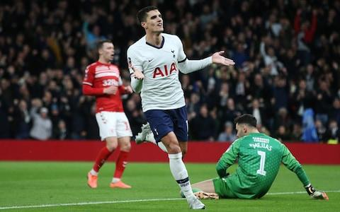 Erik Lamela wheels away after doubling Tottenham's advantage on 15 minutes - Credit: GETTY IMAGES