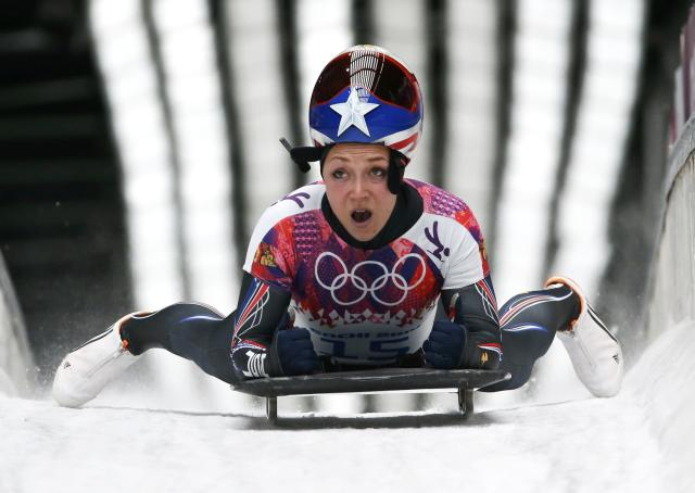 Katie Uhlaender of the U.S. finishes in the women's skeleton event at the 2014 Sochi Winter Olympics, at the Sanki Sliding Center in Rosa Khutor February 14, 2014. REUTERS/Murad Sezer (RUSSIA - Tags: OLYMPICS SPORT SKELETON)