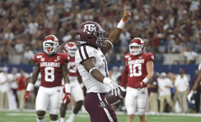 Texas A&M wide receiver Ainias Smith celebrates after scoring a touchdown against Arkansas during the first half of an NCAA college football game Saturday, Sept. 28, 2019, in Arlington, Texas. (AP Photo/Ron Jenkins)