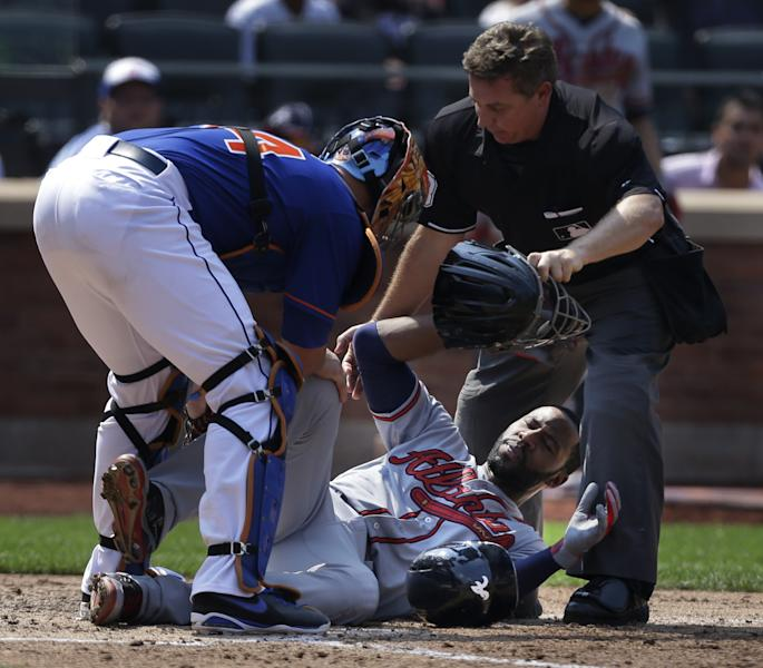 Atlanta Braves' Jason Heyward, center, is helped by New York Mets catcher John Buck, left, and umpire Greg Gibson after being hit by a 90 mph fastball thrown by New York Mets pitcher Jonathon Niese during the sixth inning of a baseball game at Citi Field, Wednesday, Aug. 21, 2013, in New York. Heyward was taken to the hospital for x-rays. (AP Photo/Seth Wenig)
