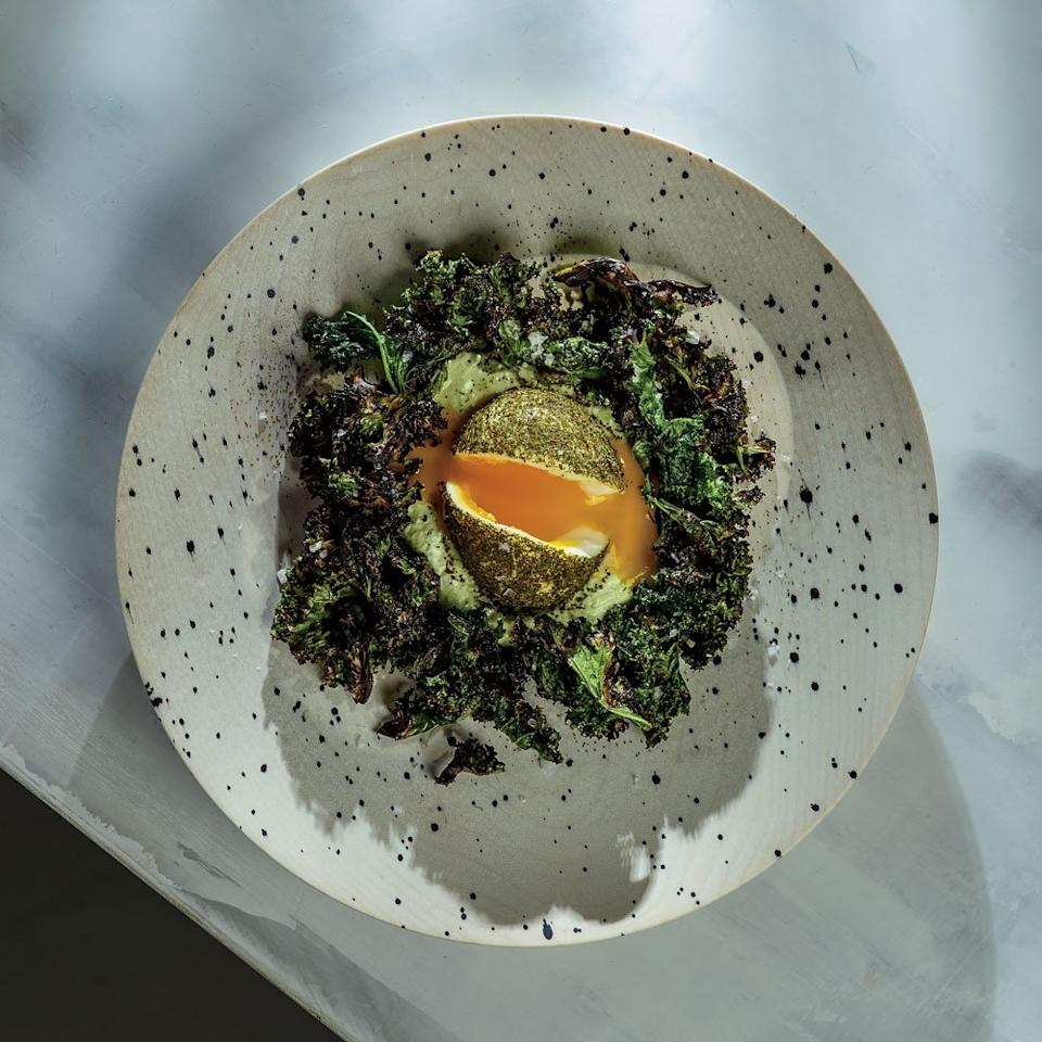 "<p>F&W Best New Chef 2017 Jay Blackinton, of Hogstone's Wood Oven on Orcas Island, Washington, takes just a few humble ingredients and turns them into a magical dish. Case in point: this ""green"" egg, which is soft-boiled and dusted in dried kale, then served on creamy arugula-laced goat cheese and surrounded by crispy grilled kale. It looks like a nest—and tastes like heaven.</p><p><a href=""https://www.foodandwine.com/recipes/green-eggs-whipped-goat-cheese-and-grilled-kale"">GO TO RECIPE</a></p>"