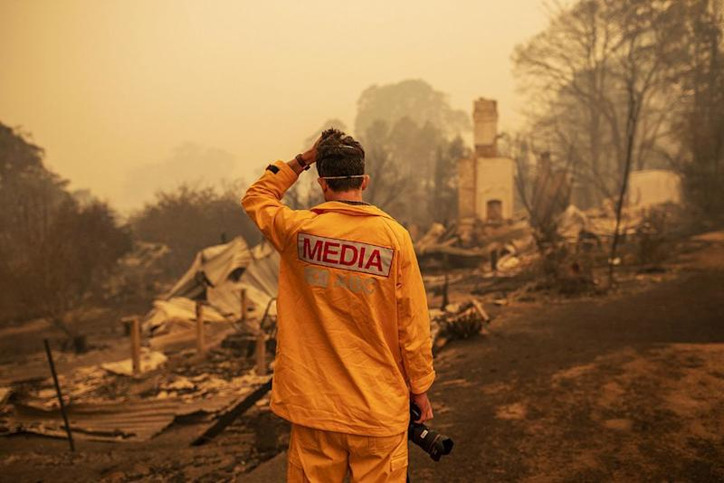 Photographer Matt Roberts looks at what was once his sister's home in Quaama, New South Wales, on Jan. 1 | SEAN DAVEY/EPA-EFE/Shutterstock