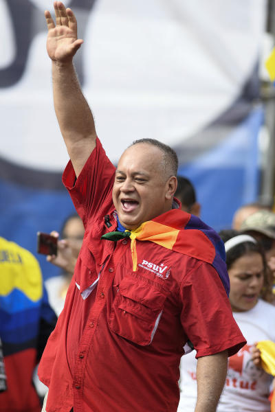 Socialist Party President Diosdado Cabello greets supporters at a pro-government rally in Caracas, Venezuela, Saturday, Nov. 16, 2019. Crowds gathered in the Venezuelan's capital for rival demonstrations on Saturday. Opposition leader Juan Guaido called for Saturday's nationwide demonstrations to re-ignite a campaign against President Nicolas Maduro launched in January that has lost steam in recent months. (AP Photo/Matias Delacroix)