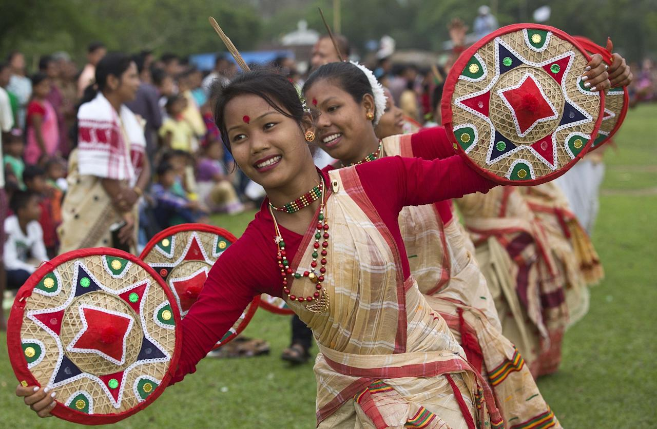 <p>Assamese girls in traditional attire perform Bihu dance during the Suwori Tribal festival in Boko, about 70 kilometers (44 miles) west of Gauhati, India, Thursday, April 20, 2017. Traditional elephant fights, elephant races, horse races, tug of war and dances mark this festival which coincides with the Assamese Rongali Bihu, or the harvest festival of the northeastern Indian state of Assam. (AP Photo/Anupam Nath) </p>