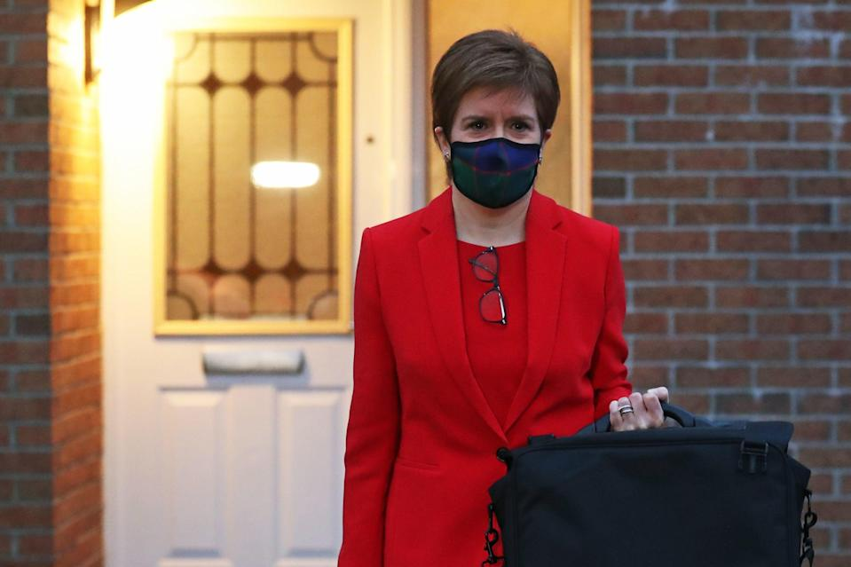 First Minister of Scotland, Nicola Sturgeon, leaves her home in Glasgow to head to Holyrood in Edinburgh to give evidence to the Scottish Parliament's inquiryPA