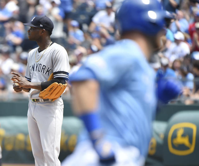 New York Yankees starting pitcher Domingo German, left, looks at the scoreboard after giving up a home run to Kansas City Royals' Ryan O'Hearn in the fourth inning during a baseball game Sunday, May 26, 2019, in Kansas City, Mo. (AP Photo/Ed Zurga)