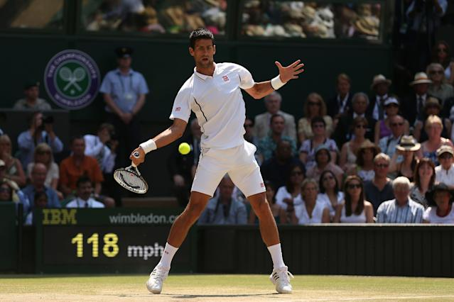 LONDON, ENGLAND - JULY 07: Novak Djokovic of Serbia plays a forehand during the Gentlemen's Singles Final match against Andy Murray of Great Britain on day thirteen of the Wimbledon Lawn Tennis Championships at the All England Lawn Tennis and Croquet Club on July 7, 2013 in London, England. (Photo by Clive Brunskill/Getty Images)
