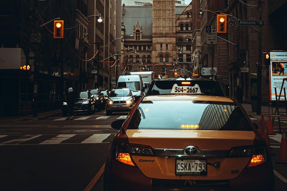 A taxi is stopped on a downtown street