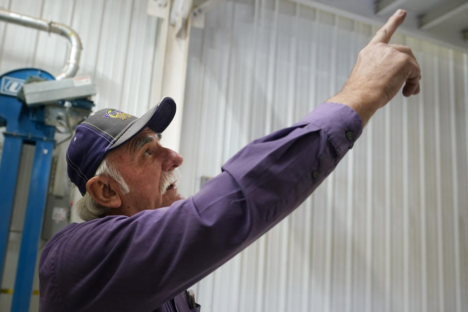 Adrian Polansky, a farmer and former executive director of the USDA's Farm Service Agency office in Kansas during the Obama administration, points out new equipment at his seed processing plant near Belleville, Kan., Friday, March 5, 2021. More than a year after two U.S. Department of Agriculture research agencies were moved from the nation's capital to Kansas City, they remain critically understaffed and some farmers are less confident in the work they produce. (AP Photo/Orlin Wagner)
