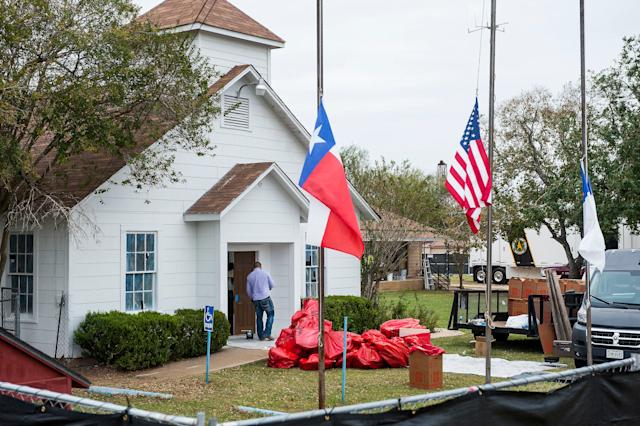 Plastic bags are piled up outside First Baptist Church in Sutherland Springs, Texas, as hazardous materials are removed from the building after themassacre.
