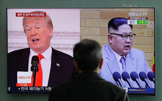 <p>A man watches a TV screen showing file footages of U.S. President Donald Trump, left, and North Korean leader Kim Jong Un, right, during a news program at the Seoul Railway Station in Seoul, South Korea on March 27, 2018. Increased activity at a North Korean nuclear site has once again caught the attention of analysts and renewed concerns about the complexities of denuclearization talks as President Donald Trump prepares for a summit with Kim Jong Un. (Photo: Lee Jin-man/AP) </p>
