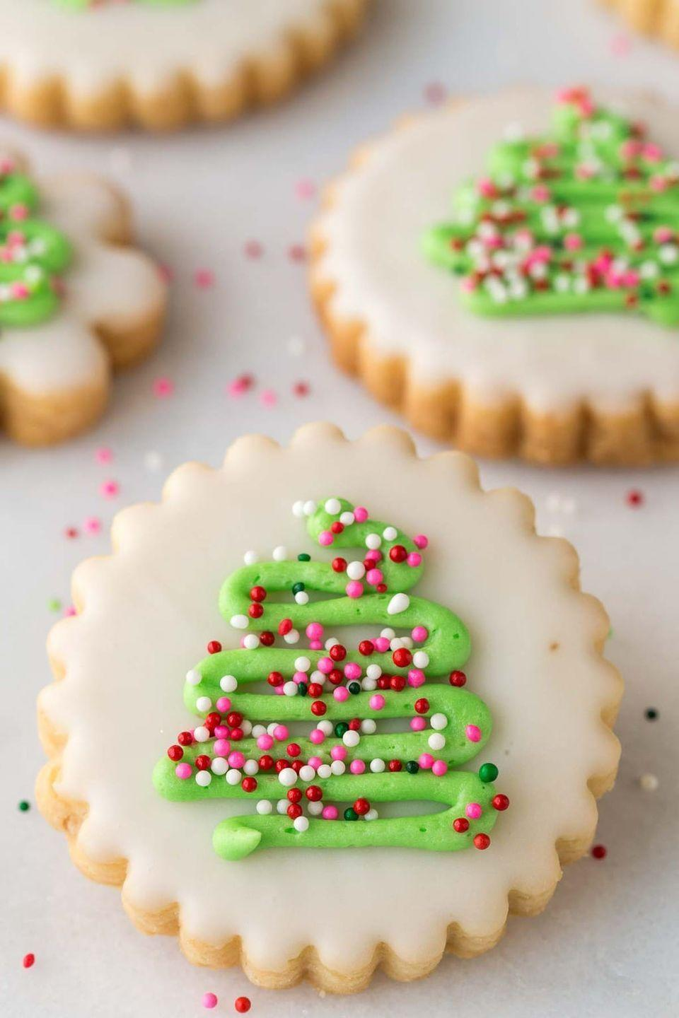 """<p>Not only are these delicate cookies beautiful, but they're also very easy to <a href=""""https://www.countryliving.com/food-drinks/g2777/christmas-sugar-cookies/"""" rel=""""nofollow noopener"""" target=""""_blank"""" data-ylk=""""slk:decorate"""" class=""""link rapid-noclick-resp"""">decorate</a>. Just follow this blogger's tips and tricks and your batch will look just as stunning as hers.</p><p><strong>Get the recipe at <a href=""""https://thecafesucrefarine.com/christmas-shortbread-cookies/"""" rel=""""nofollow noopener"""" target=""""_blank"""" data-ylk=""""slk:The Café Sucre Farine"""" class=""""link rapid-noclick-resp"""">The Café Sucre Farine</a>.</strong><br></p><p><strong><a class=""""link rapid-noclick-resp"""" href=""""https://www.amazon.com/dp/B07FYRHSW4/?tag=syn-yahoo-20&ascsubtag=%5Bartid%7C10050.g.647%5Bsrc%7Cyahoo-us"""" rel=""""nofollow noopener"""" target=""""_blank"""" data-ylk=""""slk:SHOP DECORATING TIPS"""">SHOP DECORATING TIPS</a><br></strong></p>"""
