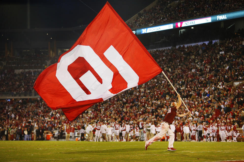 NORMAN, OK - NOVEMBER 23:  A Ruf/Nek parades the Oklahoma Sooners flag around the field after a touchdown against the TCU Horned Frogs on November 23, 2019 at Gaylord Family Oklahoma Memorial Stadium in Norman, Oklahoma.  OU held on to win 28-24.  (Photo by Brian Bahr/Getty Images)