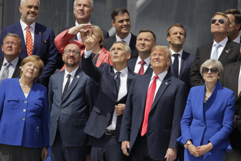German Chancellor Angela Merkel, Belgian Prime Minister Charles Michel, NATO Secretary-General Jens Stoltenberg, U.S. President Donald Trump and British Prime Minister Theresa May, front row from left, watch a fly-by during a summit of heads of state and government at NATO headquarters in Brussels Wednesday, July 11, 2018. NATO leaders gather in Brussels for a two-day summit to discuss Russia, Iraq and their mission in Afghanistan. (AP Photo/Markus Schreiber)