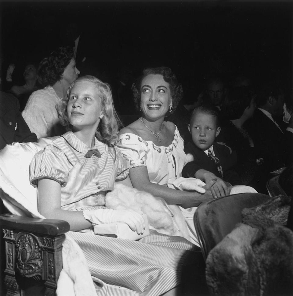 <p>Decked out in their Hollywood best, Christina and Christopher Crawford accompanied their mother to the premiere of <em>The Hasty Heart </em>in Los Angeles in 1949. Sounds like a fun family outing to us!</p>