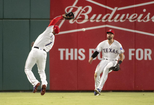 Texas Rangers shortstop Elvis Andrus (1) can't make the catch on a pop fly by Los Angeles Angels' Andrelton Simmons as left fielder Joey Gallo backs up the play during the ninth inning of a baseball game, Thursday, Aug. 16, 2018, in Arlington, Texas. Texas won 8-6. (AP Photo/Jeffrey McWhorter)