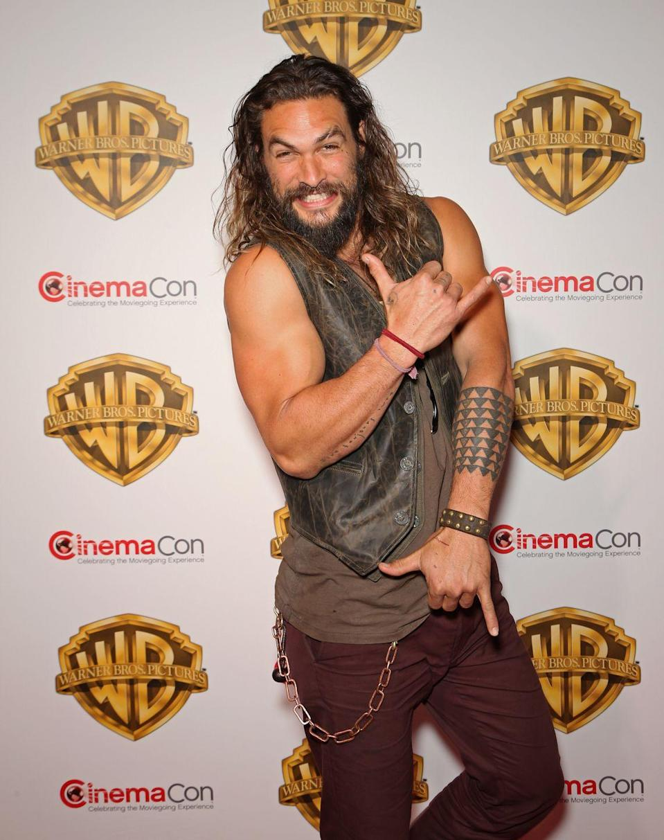 "<p>Jason Momoa may not be <em>trying </em>to flex here, but his muscles couldn't help but show off. To make sure that he stays in <em>Aquaman </em>shape, Momoa follows <a href=""https://www.menshealth.com/entertainment/a32171037/jason-momoa-kids-home-workout-quarantine/"" rel=""nofollow noopener"" target=""_blank"" data-ylk=""slk:untraditional workouts, like hiking up volcanoes"" class=""link rapid-noclick-resp"">untraditional workouts, like hiking up volcanoes</a>.</p>"