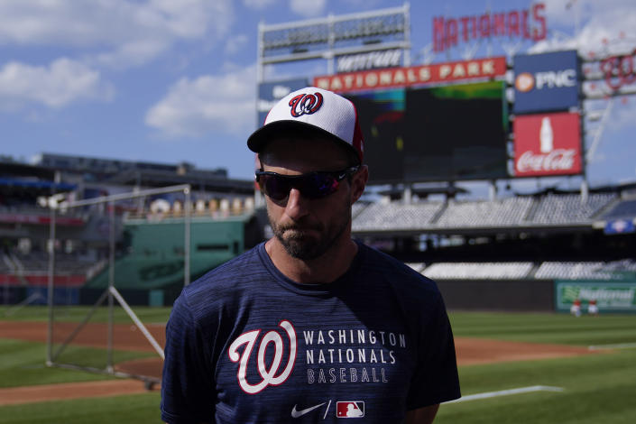 Washington Nationals pitcher Max Scherzer pauses as he speaks to media on the field before a baseball game against Pittsburgh Pirates, Monday, June 14, 2021, in Washington. (AP Photo/Carolyn Kaster)