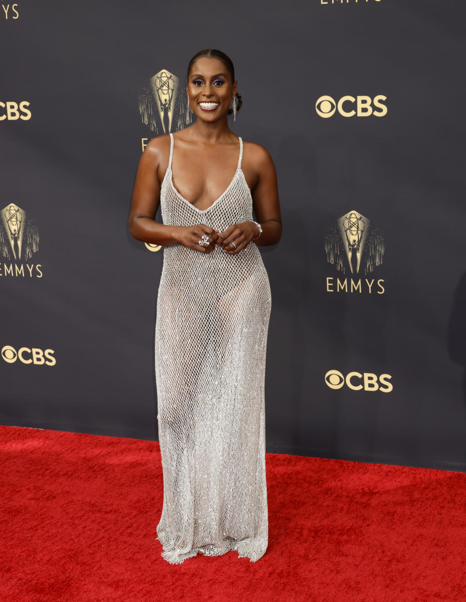 Issa Rae wears a silver mesh dress at the 73RD EMMY AWARDS on Sunday, Sept. 19