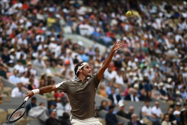 Back in business: Roger Federer returns the ball to Italy's Lorenzo Sonego (AFP Photo/Anne-Christine POUJOULAT)
