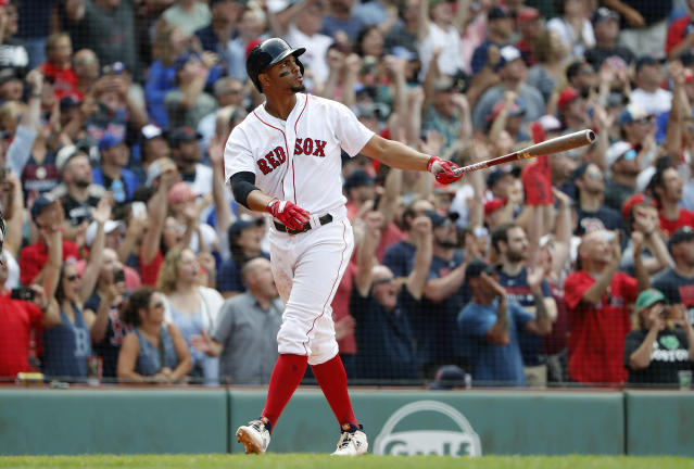 Boston Red Sox' Xander Bogaerts watches his grand slam during the 10th inning of their 6-2 over the Toronto Blue Jays in a baseball game Saturday, July 14, 2018, in Boston. (AP Photo/Winslow Townson)