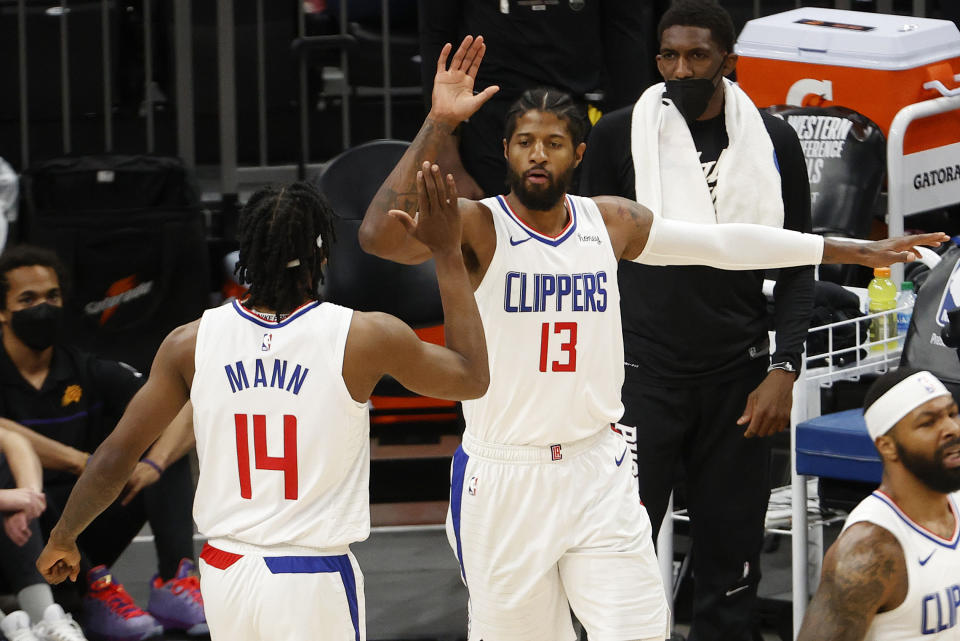 Paul George of the LA Clippers celebrates with Terance Mann