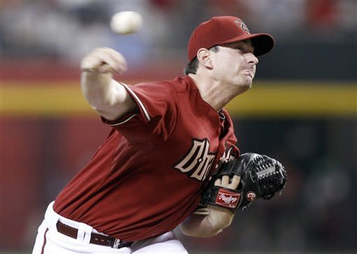 Arizona Diamondbacks' Daniel Hudson releases a pitch against the Milwaukee Brewers in the third inning of a baseball game Sunday, May 27, 2012, in Phoenix. (AP Photo/Paul Connors)
