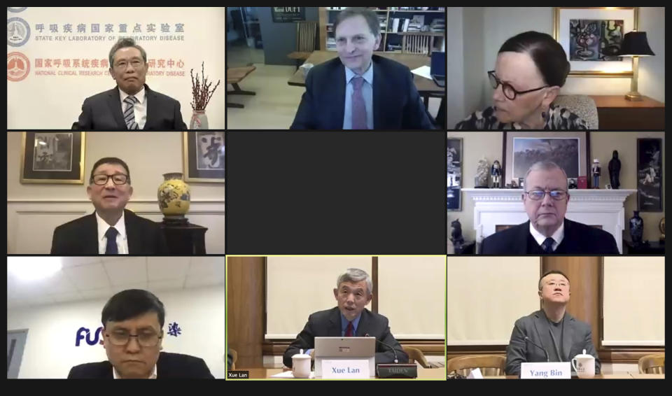 In this image from a video conference and released by Brookings Institution and Tsinghua University, participants take part in a seminar Monday, March 1, 2021 hosted by the Brookings Institution in Washington and Tsinghua University in Beijing between top U.S. and Chinese medical experts. China is lagging in its current vaccination rollout, but will aim to vaccinate 40% of its population by June, the head of a government expert team said during the conference. (Brookings Institution and Tsinghua University via AP)