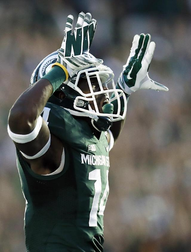 Michigan State wide receiver Tony Lippett celebrates his touchdown against Stanford during the second half of the Rose Bowl NCAA college football game on Wednesday, Jan. 1, 2014, in Pasadena, Calif. (AP Photo/Danny Moloshok)