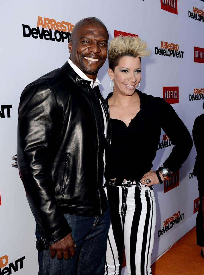 "LOS ANGELES, CA - APRIL 29:  Actor Terry Crews (L) and his wife Rebecca King-Crews arrive at the premiere of Netflix's ""Arrested Development"" Season 4 at the Chinese Theatre on April 29, 2013 in Los Angeles, California.  (Photo by Kevin Winter/Getty Images)"