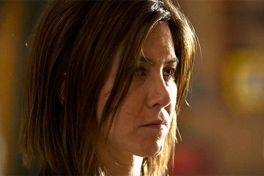 The actress trades her shiny hair, glowing skin, and form-fitting clothing, for a frumpy wardrobe with a makeup-free face and dark sense of humor. As someone obsessed with another woman's suicide, Aniston is not bubbly or flirty or high energy as we're used to seeing her, but the transformation is minimal.