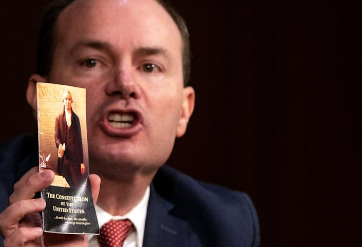 Sen. Mike Lee (R-Utah) holds up a copy of the U.S. Constitution during the Supreme Court confirmation hearing for Judge Amy Coney Barrett on Monday. (Photo: Alex Edelman-Pool/Getty Images)