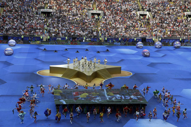 Artists perform during a ceremony before the final match between France and Croatia at the 2018 soccer World Cup in the Luzhniki Stadium in Moscow, Russia, Sunday, July 15, 2018. (AP Photo/Thanassis Stavrakis)