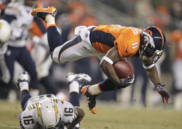 Denver Broncos wide receiver Trindon Holliday (11) is tripped up by San Diego Chargers wide receiver Seyi Ajirotutu (16) on a kick-off return in the second quarter of an NFL football game, Thursday, Dec. 12, 2013, in Denver. (AP Photo/Joe Mahoney)