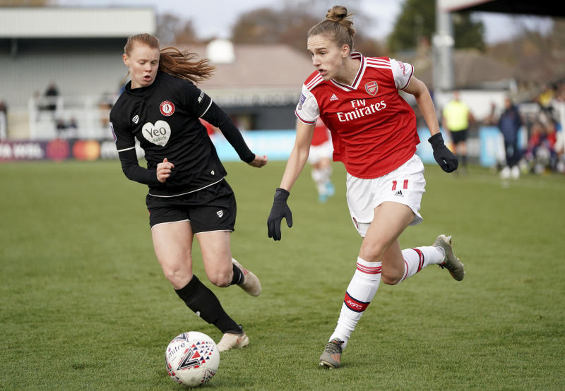 Arsenal's Vivianne Miedema, right, during the FA Women's Super League match against Bristol City at Meadow Park, Borehamwood, England, Sunday Dec. 1, 2019. (Tess Derry/PA via AP)