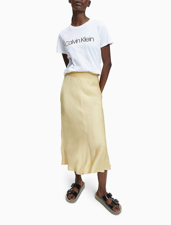 """<p><strong>Calvin Klein</strong></p><p>calvinklein.us</p><p><strong>$51.35</strong></p><p><a href=""""https://go.redirectingat.com?id=74968X1596630&url=https%3A%2F%2Fwww.calvinklein.us%2Fen%2Fwomens-clothing%2Fwomens-apparel%2Fwomens-shop-all%2Fbias-cut-midi-skirt-10092099&sref=https%3A%2F%2Fwww.cosmopolitan.com%2Fstyle-beauty%2Ffashion%2Fg35536095%2Fbest-hauliday-fashion-editor-picks%2F"""" rel=""""nofollow noopener"""" target=""""_blank"""" data-ylk=""""slk:Shop Now"""" class=""""link rapid-noclick-resp"""">Shop Now</a></p><p>Currently counting down the days until spring, and this butter yellow Calvin Klein midi skirt definitely makes me look forward to the new season. </p><p><strong>Sale: </strong>20% off with code HAULIDAY</p>"""