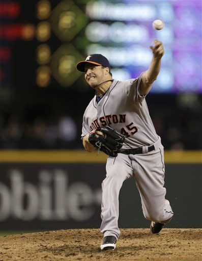 Houston Astros starting pitcher Erik Bedard throws to the Seattle Mariners in the fourth inning of a baseball game, Tuesday, April 9, 2013, in Seattle. (AP Photo/Ted S. Warren)