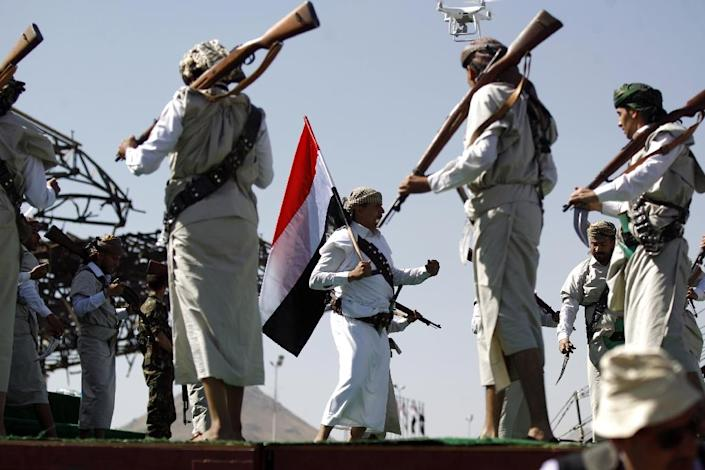 Performers dance during a rally to mark three years of war in Yemen, in the capital Sanaa on March 26, 2018 (AFP Photo/MOHAMMED HUWAIS)