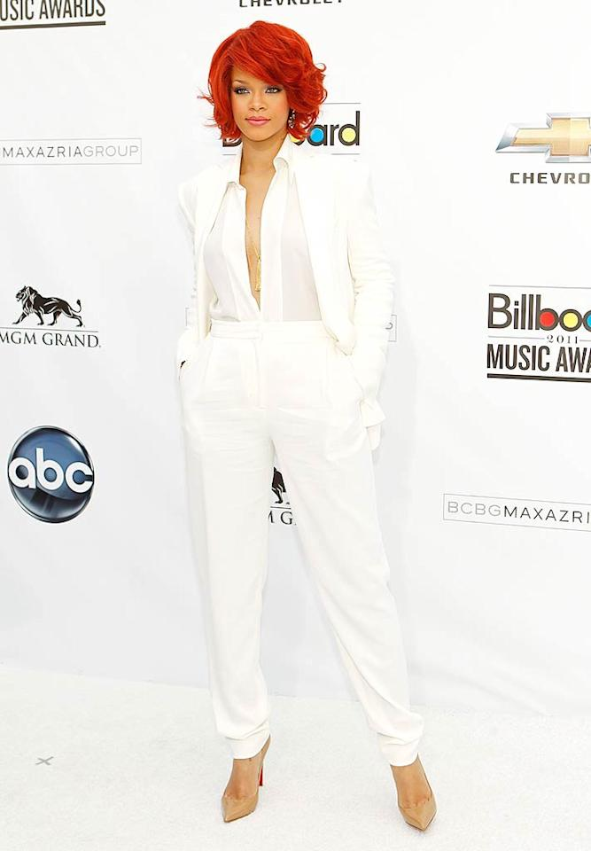 """Following in Selena's footsteps was """"S&M"""" singer Rihanna, who took Sin City by storm in a sharp, white Max Azria suit, nude Christian Louboutin heels, pink lipstick, and a gold pendant necklace. Isaac Brekken/<a href=""""http://www.gettyimages.com/"""" target=""""new"""">GettyImages.com</a> - May 22, 2011"""