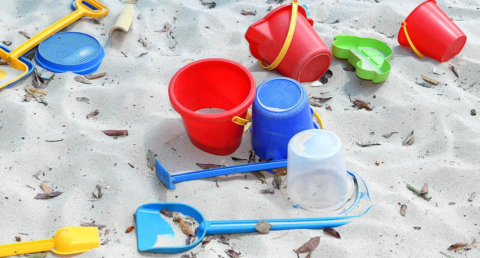 File photo of plastic buckets and shovels in a sandpit. Source: AAP