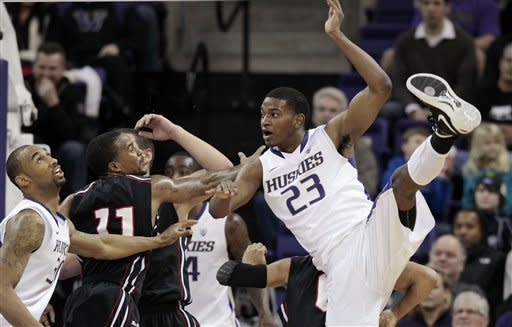 Washington's C.J. Wilcox (23) loses his balance after getting off a pass against Cal State Northridge in the first half of an NCAA college basketball game Thursday, Dec. 22, 2011, in Seattle. (AP Photo/Elaine Thompson)