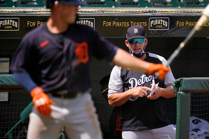 Detroit Tigers manager A.J. Hinch, right, watches an at-bat by Spencer Torkelson during the fifth inning of a spring training exhibition baseball game against the Pittsburgh Pirates in Bradenton, Fla., Friday, March 26, 2021.