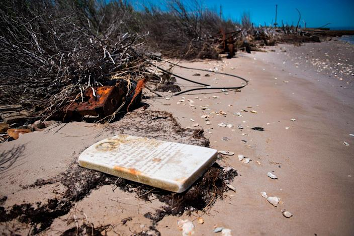 <p>A grave stone rests on the beach where a cemetery once stood but has been washed away due to erosion in an area called Canaan in Tangier, Virginia, May 16, 2017, where climate change and rising sea levels threaten the inhabitants of the slowly sinking island.<br> (Jim Watson/AFP/Getty Images) </p>