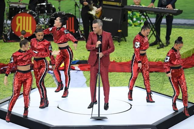 <p>MOSCOW, RUSSIA – JUNE 14: British popstar Robbie Williams perfporms prior to the 2018 FIFA World Cup Russia Group A match between Russia and Saudi Arabia at Luzhniki Stadium on June 14, 2018 in Moscow, Russia. (Photo by Shaun Botterill/Getty Images) </p>