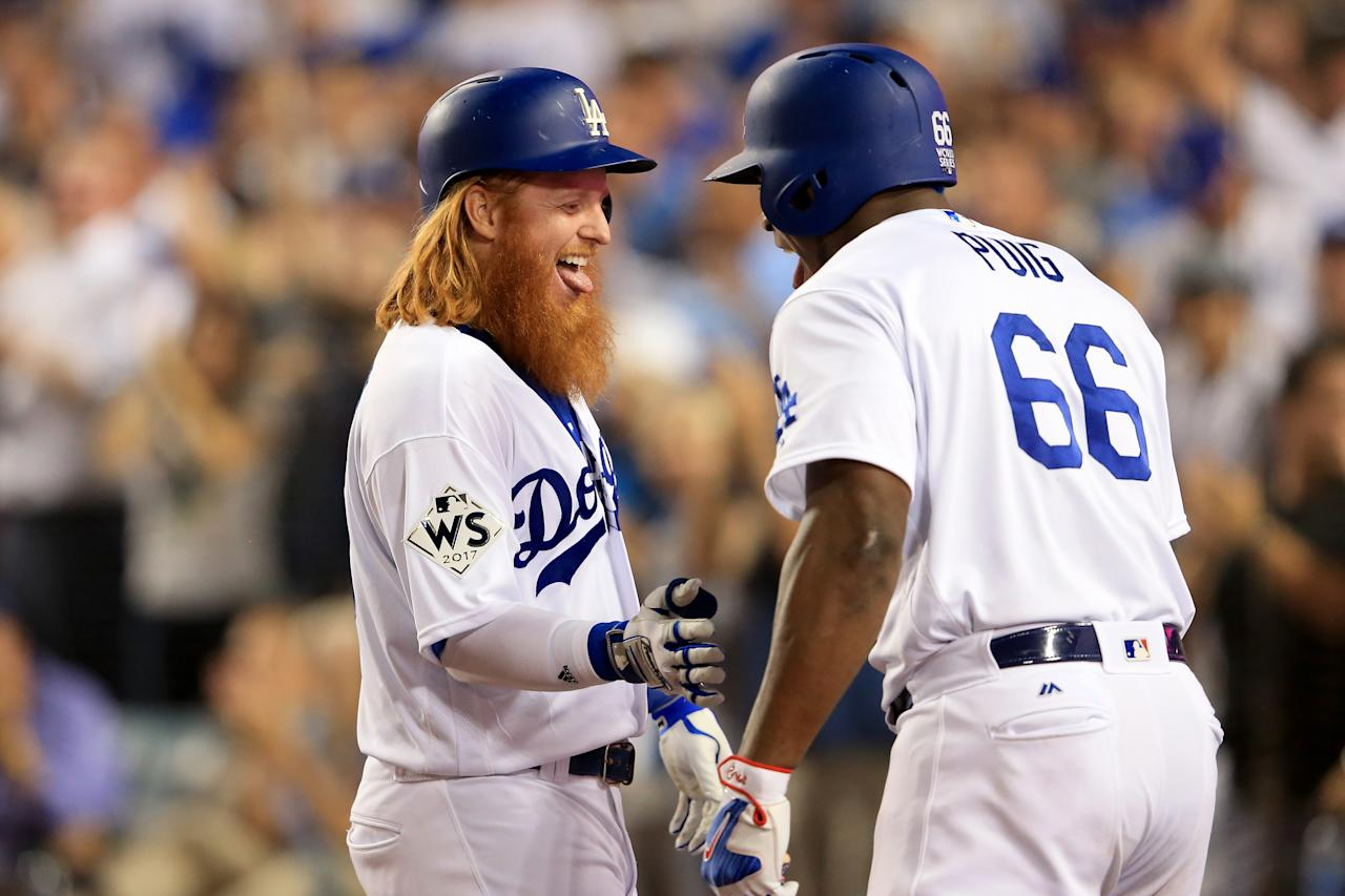 <p>Justin Turner #10 of the Los Angeles Dodgers celebrates with Yasiel Puig #66 after hitting a two-run home run during the sixth inning against the Houston Astros in game one of the 2017 World Series at Dodger Stadium on October 24, 2017 in Los Angeles, California. (Photo by Sean M. Haffey/Getty Images) </p>