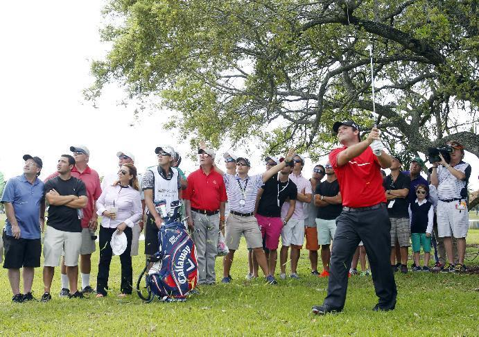 Patrick Reed watches his shot from the rough on the seventh hole during the final round of the Cadillac Championship golf tournament on Sunday, March 9, 2014, in Doral, Fla. (AP Photo/Wilfredo Lee)