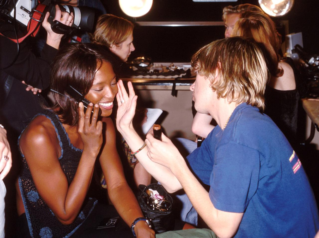 Naomi Campbell backstage at the Tommy Hilfiger fall/winter 1999 show during New York Fashion Week, February 1999. Photo courtesy of Getty Images.