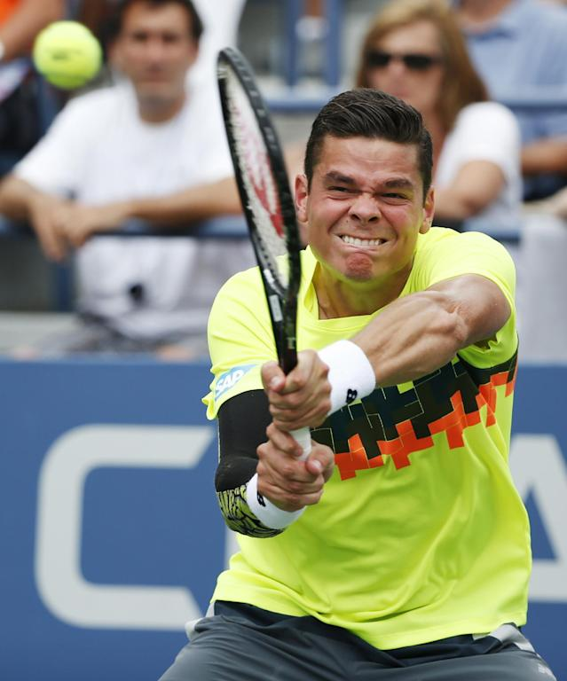 Milos Raonic, of Canada, returns a shot against Victor Estrella Burgos, of Dominican Republic, during the third round of the 2014 U.S. Open tennis tournament, Saturday, Aug. 30, 2014, in New York. (AP Photo/Kathy Willens)